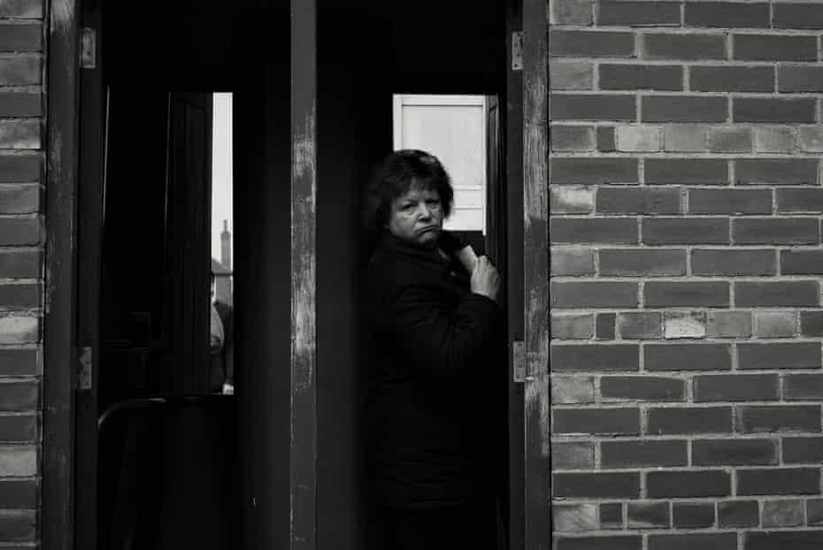A woman negotiates a turnstile.