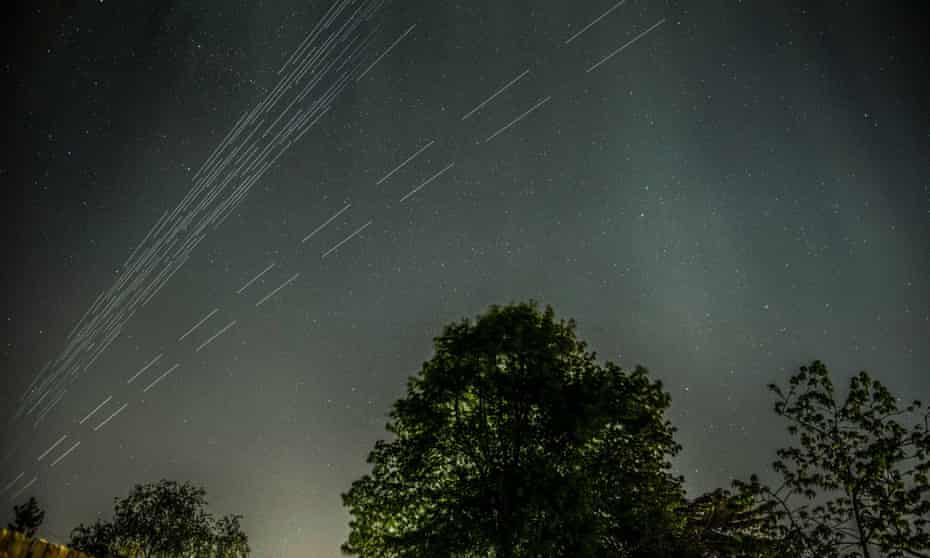 A composite of long exposure images showing SpaceX's Starlink satellite constellation passing over London earlier this year.