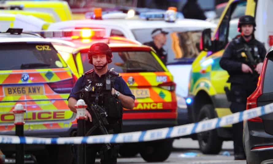 Armed police stand guard near London Bridge after the attack.