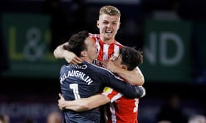 Sunderland's Max Power (top), celebrates with Jon McLaughlin, who made some fine saves, and Luke O'Nien after edging past Portsmouth in the League One play-off semi-final.