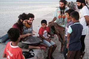 Iranian travellers Sina and Ershad (left) teach local kids how to play hang drum. Sina and Ershad are both local Instagram stars having over 120 000 followers combined. Hormoz. Iran