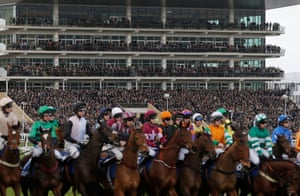 The packed stands watch the start of the Pertemps Network Final Handicap Hurdle