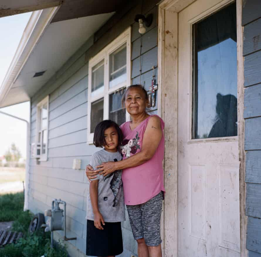 Valerie Whitehawk, 61, and her grand-daughter, Macylilly, eight, outside of their home on Fort Peck Indian Reservation.