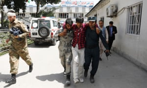 An injured man is carried to hospital after the blast in Kabul, Afghanistan, on 7 August.