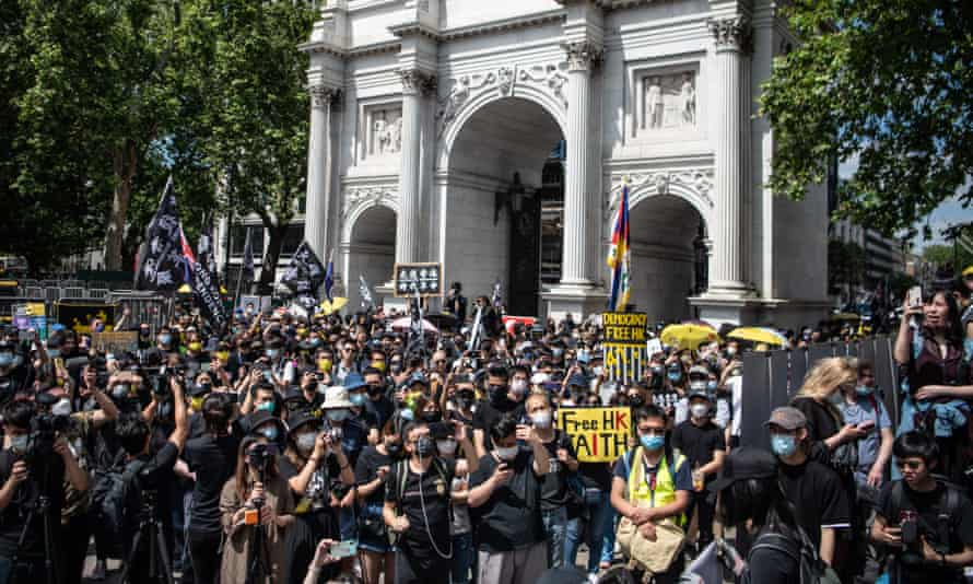 Protesters attend a rally at Marble Arch in London calling for democracy in Hong Kong