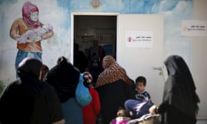 Syrian refugee women attend a breast cancer awareness seminar held by Save the Children at al Zaatari refugee camp in the Jordanian city of Mafraq.