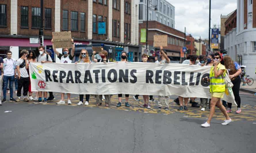 Reparations Rebellion and Brixton Extinction Rebellion protesters during the Afrikan Emancipation Day Reparations march in Brixton, London on 1 August 2020