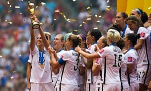 Carli Lloyd lifts the Women's World Cup trophy in July 2015.
