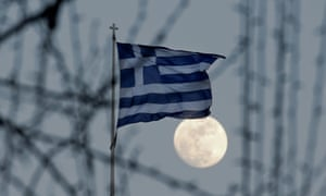 A Greek national flag flutters as the moon rises in Athens on Thursday.