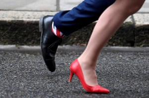 London, England. Matt Hancock, the health and social care secretary, is spotted wearing Union Jack socks as he leaves with the leader of the House of Lords, Natalie Evans, after a cabinet meeting in Downing Street