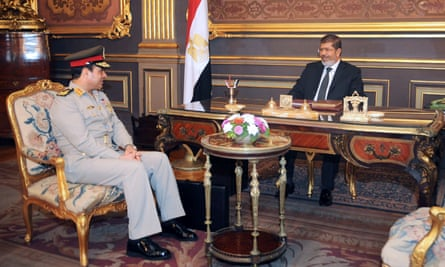 Morsi, right, and Abdel-Fatah al-Sisi at the presidential palace in Cairo in 2012