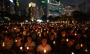 People hold candles as they take part in a candlelight vigil in Victoria Park, Hong Kong, on 4 June 2019 to mark the anniversary of the Tiananmen Square massacre.