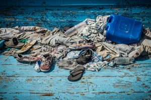 Personal items left behind by migrants who travelled by boat from Libya are photographed in the Sicilian harbour of Pozzallo