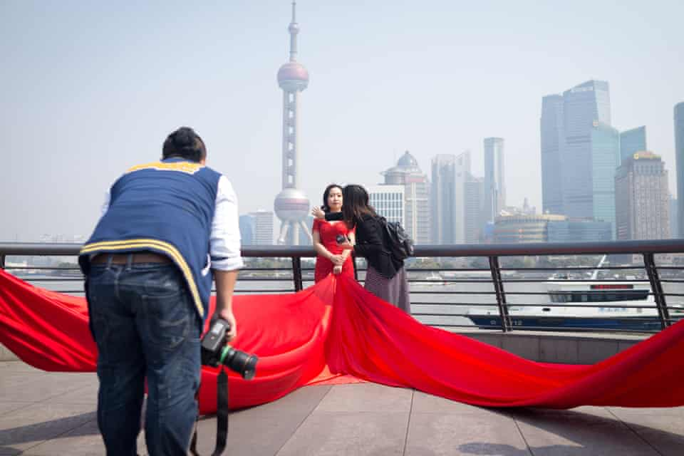 A warm spring morning in Shanghai on The Bund, where several pre-wedding shoots are happening simultaneously