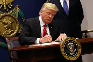 Donald Trump signing the executive order to impose tighter vetting of travellers entering the USA