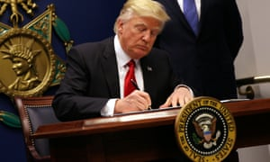 Donald Trump signs an executive order to impose tighter vetting of travellers entering the US, targeting Muslim-majority countries and shutting down refugee entry.