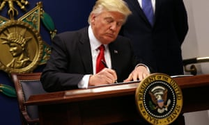 President Donald Trump signs the executive order banning the entrance to the US of travellers from seven Muslim-majority countries and of all refugees
