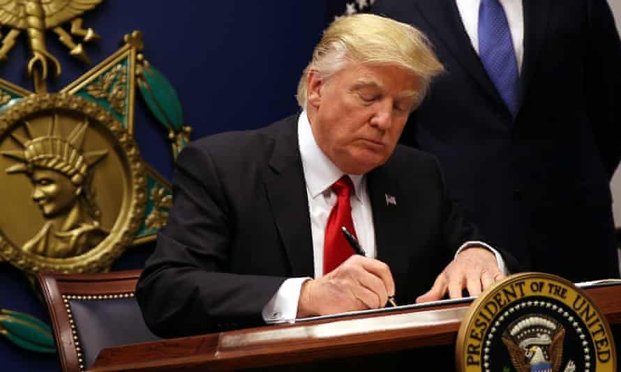 Donald Trump signs an executive