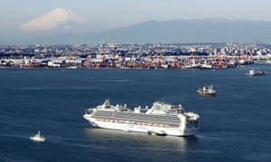 The Diamond Princess cruise ship quarantined off Yokohama in Japan. Mount Fuji can be seen in the background.