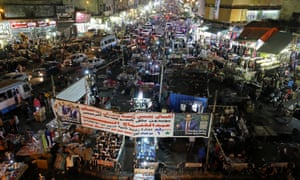 People shop at a Cairo market