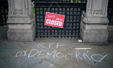 A sign left by a protester outside the Houses of Parliament