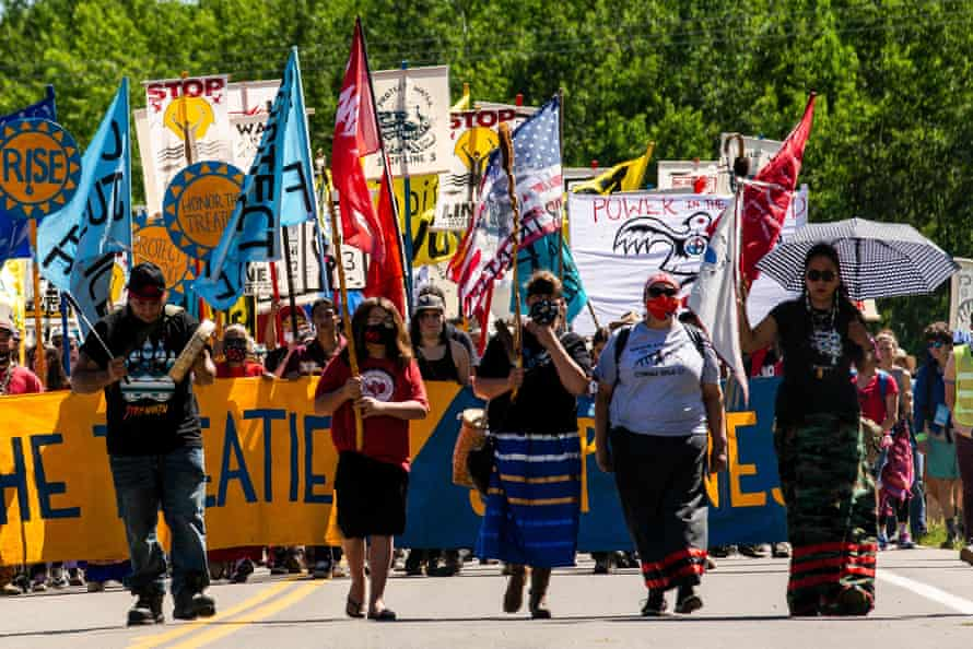 Climate activists and Indigenous community members march in Solway, Minnesota.