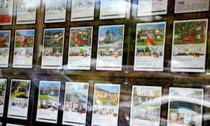 signs in real estate agent window