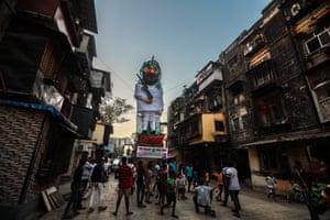 Mumbai, India People stand next to an effigy of Jaish-e-Mohammad chief Masood Azhar