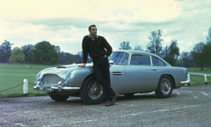 Sean Connery in Goldfinger with an Aston Martin DB5