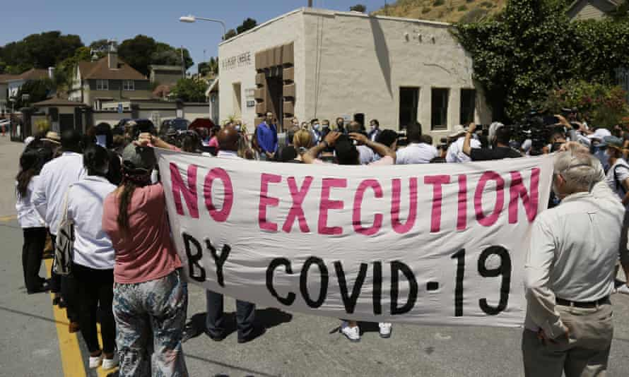 People protest against the alleged mishandling of prison transfers which have caused outbreaks of coronavirus, outside San Quentin State Prison in California.