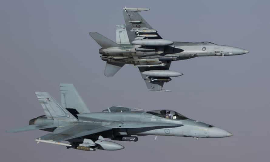 Two RAAF' F/A-18A Hornets peel away from an airborne tanker while returning to base after striking an Isis armoured personnel carrier in Syria on 14 September.