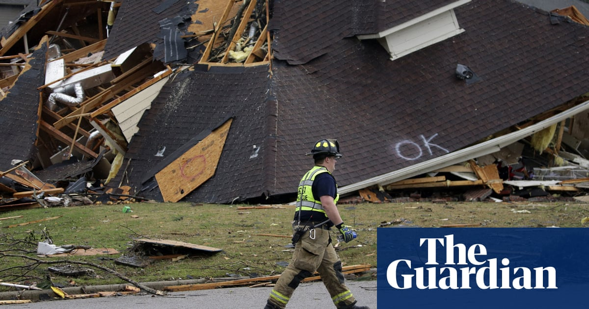 Multiple tornadoes tear across US south-east causing deaths and wreckage