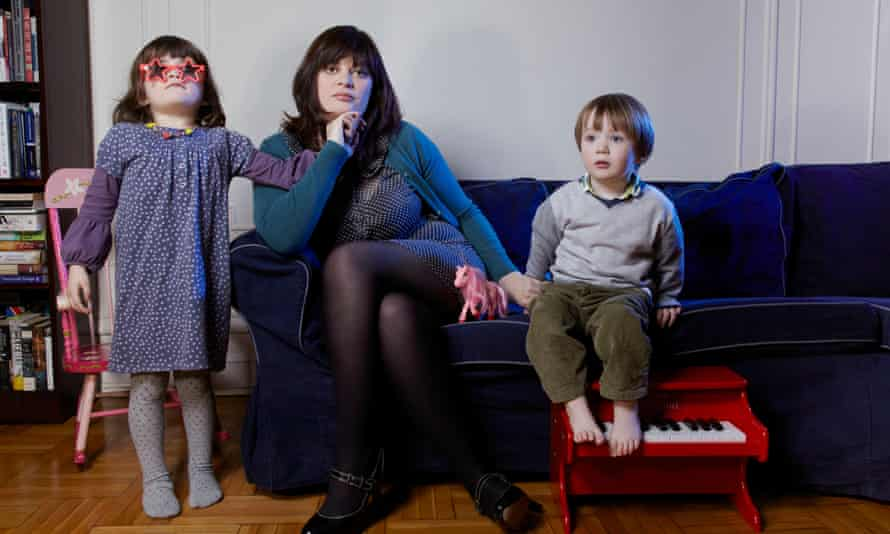 Sarah Hughes at home in New York with her children in 2012.