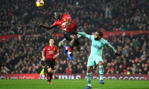 Eric Bailly of Manchester United battles for possession with Arsenal's Alexandre Lacazette.