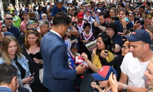 The Roosters' Latrell Mitchell signs autographs at the NRL Fan Fest event at Martin Place in Sydney