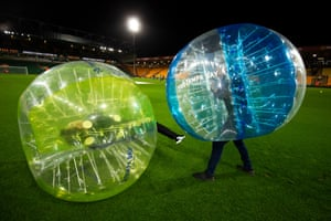 Gary Neville (left) and Jamie Carragher (right) play zorb football before Norwich City v Watford at Carrow Road.