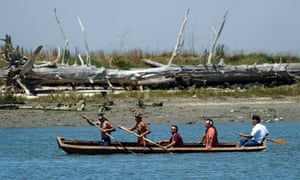 Members of the Wiyot Tribe paddle a redwood canoe in Eureka, California, as part of a ceremony where the city relinquished possession of 40 acres of land previously occupied by the Wiyots in 1860.