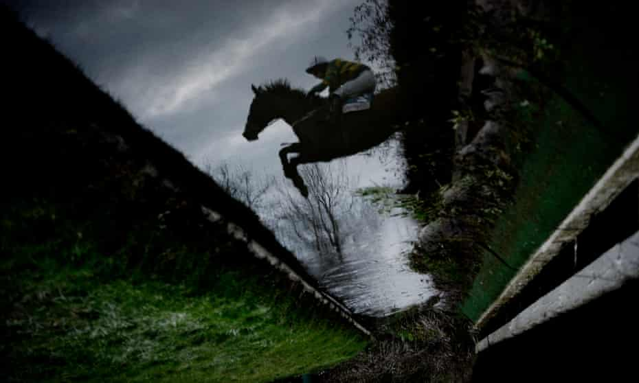 Josh Halley and Outlaw Pete jump the water ditch at Cheltenham Festival in 2013.