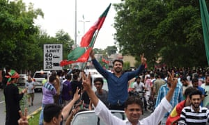 Supporters of Pakistani cricket star-turned-politician and head of the Pakistan Tehreek-e-Insaf (PTI) Imran Khan cheer as they take to the street to celebrate after polls closed