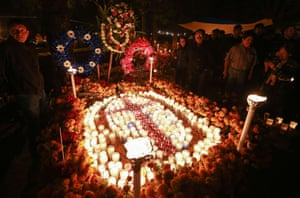 Mexico: Families decorate a relative's grave at a cemetery in Tzintzuntzan, Michoacán State