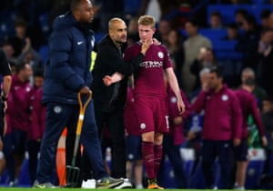 Pep Guardiola speaks to Kevin De Bruyne after the game.