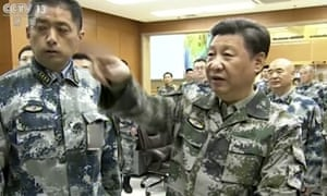 Xi Jinping, right, in military uniform