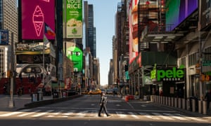 A police officer crosses the street in a nearly empty Times Square in New York City.