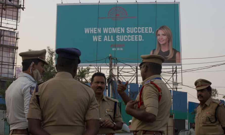 An Indian police officer briefs colleagues in Hyderabad, India, in front of a billboard of Ivanka Trump.