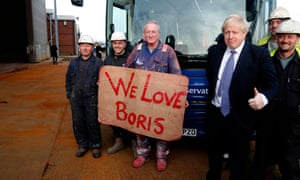 Boris Johnson with workers in Middlesbrough during the election campaign.
