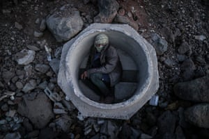 An Afghan boy hides inside a concrete sewer pipe next to a railway after crossing the Iran-Turkey border. People often wait for days for their smugglers to transfer them to the city of Diyarbakir to get to west Turkey. Smugglers charge between US$600 and US41,000 per person, depending on the security situation at the border.