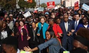 Democratic presidential candidates Amy Klobuchar and Elizabeth Warren march with Al Sharpton and former Democratic presidential candidate former South Bend, Indiana Mayor Pete Buttigieg