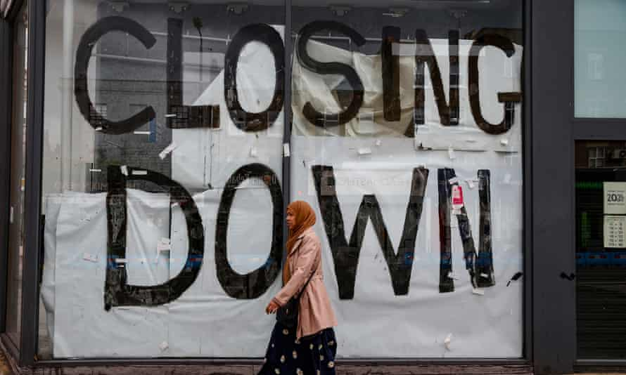 Shop with 'closing down' written in window