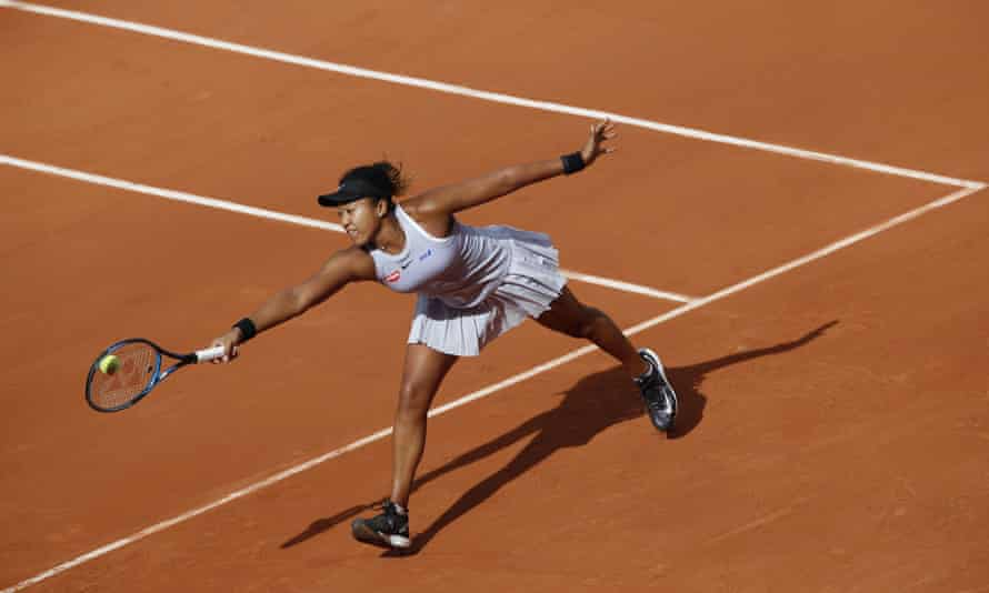 Japan's Naomi Osaka stretches to return a shot against Slovakia's Anna Karolina Schmiedlova during their first round match at the French Open on Tuesday.