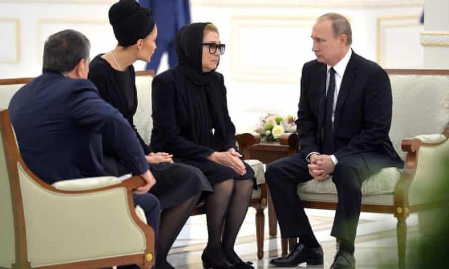 Karimov's wife Tatyana Akbarovna Karimova and daughter Lola are consoled by Vladimir Putin.